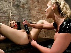 Stunning blonde mistress is disciplining sweet babe with rough bdsm punishment