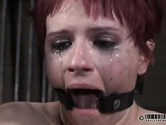 Crying redhead beauty endures master's painful and lusty caning disciplining