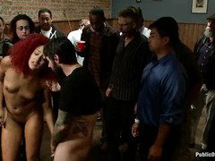Redhead ebony rag doll receives an explicit public punishment for her lusty sins