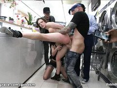Babe is made to clean up her squirt during her public punishment at a laundry shop