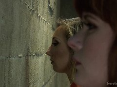 Two gorgeous babes are given anal punishment by mistress in the prison