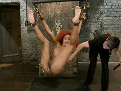 Tied up redhead ebony wants to be taken roughly and manipulated till she cums