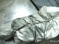 Babe is tied tightly in a sleeping bag and brought in for some lusty beatings