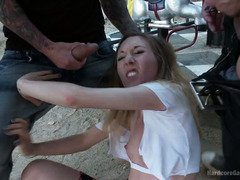 Naughty brunette receives rough gangbang punishment at an outdoor carousel