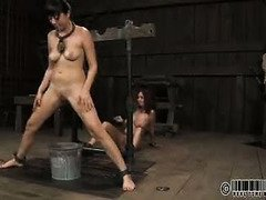 Submissive slave babes are punished for master's horny and entertaining needs