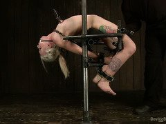 Excruciating and lewd pussy punishment for a demure blonde slave