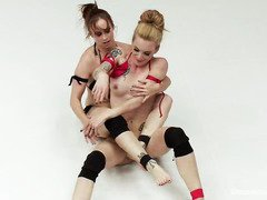 Sweet blonde receives a carnal fingering during her tough wrestling match