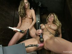 Two sexy blonde goddesses are having explosive fun with fucking machines