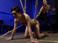 Bounded and gagged brunette endures the sweet torture of her sexy mistress