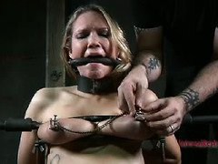 Tattooed blonde is crying furiously from her grueling bondage punishment