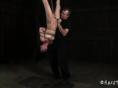 Suspended beauty is feeling vulnerable from master's upside down punishment
