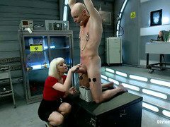 Stunning blonde doctor is studying the effects of pain and  humiliation on stud