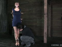 Helpless brunette is crying with fear as she waits for master's kinky beatings