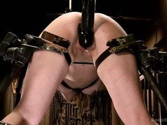 Demure brunette is moaning and screaming wildly during her grueling punishment