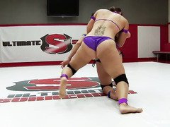 Pretty Asian fighter faces a tough competitor during her sexy wrestling match