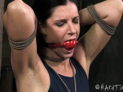 Dark-haired beauty is drooling excessively as master torments her tits with pumps