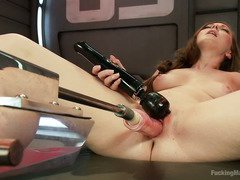 Alluring brunette is totally sated from playing with several fucking machines