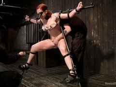 Slave beauty is screaming with pain pleasures as she experiences rough punishment