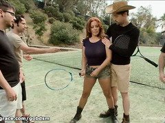 An arousing gangbang lesson is given to big tits brunette on a tennis court