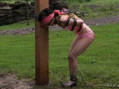 Gagged and bounded sweetheart receives a dirty mud splashing punishment