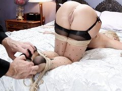 Gorgeous blonde is fulfilling her lusty bondage fantasy with a tough master