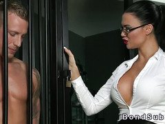 Muscled sub male licks busty mistress in dungeon