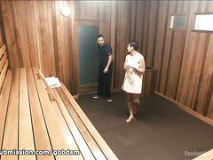 Stunning brunette submits to a horny stud after passing out from the sauna heat