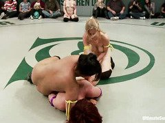 Tough and sensual wrestling between two attractive fighter babes' teams