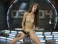 Skinny sweetheart is experiencing wanton joy from playing with the fucking machines