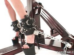 BDSM dominatrix using pussy pump on her aroused sex slave