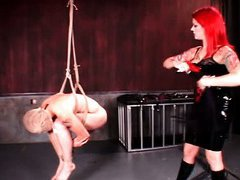 Slutty BDSM mistress using her male sex slave for torture