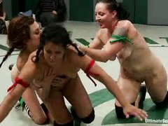 The spectators are growing wild with joy from watching babes' lusty wrestling