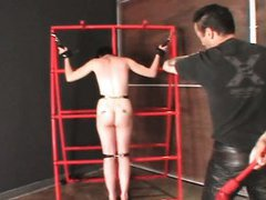 Naked brunette enjoying a BDSM treatment while tied up