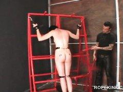 Naked brunette enjoying a BDSM treatment while tied up