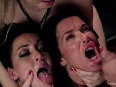 Two gorgeous slaves are being punished by mistress for playing with her man