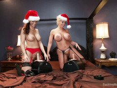 It is the holiday season and two gorgeous babes are having fun with the sybian machines