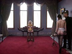 Brunette slave is punished for disturbing blonde slave without master's permission