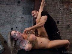 Stunning blonde with massive tits receives hardcore pounding during bondage sex