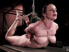 Voluptuous redhead slave experiences rough bondage punishment for her tight beaver
