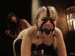 Demure blonde is punished by sexy brunette mistress for having a dirty and lusty cunt
