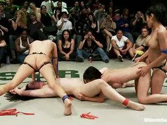 Two fighter babes suffered under the hands of the wrestling match winners