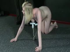 A stunning blonde performs exercises with her tits clamped