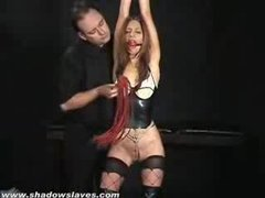 A gagged slut gets her pussy tortured and flogged