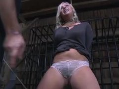 A submissive blonde in high heels gets tied and whipped