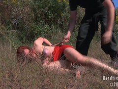 A hot slave girl gets tied up outdoors and face fucked
