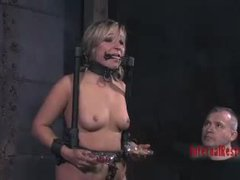 A blond slut in stockings sucks on a cock while being caned