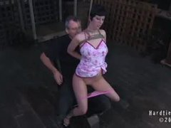 A nasty brunette in a cute dress gets fucked and punished