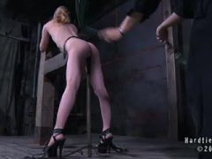 A tight bodied blonde takes flogging in intense rope restraints
