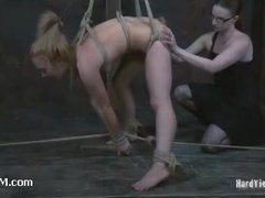 A virgin blonde agonizing in sophisticated bondage suspensions