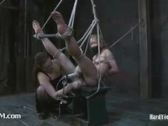 A virgin blonde agonizing in sophisticated bondage suspensions